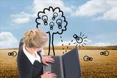 Composite image of businesswoman using laptop — Stok fotoğraf