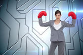 Businesswoman with boxing gloves — Stock Photo
