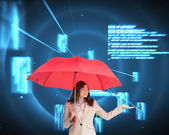 Businesswoman holding red umbrella — Stock Photo