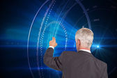 Composite image of rear view of stylish mature businessman pointing finger — Stock Photo