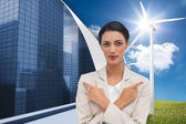 Charismatic businesswoman with her arms crossed — Stock Photo