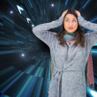 Composite image of anxious pretty brunette wearing winter clothe — Stok Fotoğraf #38530871