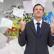 Businessman with fingers crossed is looking up — Stock Photo