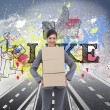 Composite image of smiling businesswoman carrying cardboard boxes — Stock Photo #38534167
