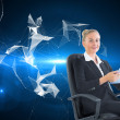 Stock Photo: Blonde businesswomsitting on swivel chair with tablet