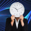 Businesswoman in suit holding a clock — Stock Photo #38535163