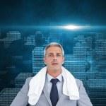 Sporty businessman with white towel — Stock Photo