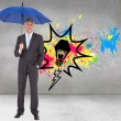 Businessman holding blue umbrella — Stock Photo