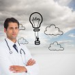 Serious doctor with arms crossed — Stock Photo