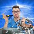Stock Photo: Confused young it professional with screw driver