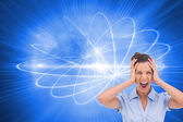 Composite image of stressed businessswoman with hand on her head — Stock Photo