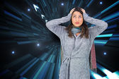 Composite image of anxious pretty brunette wearing winter clothe — Foto Stock