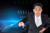 Composite image of unsmiling asian businessman pointing — Stock Photo