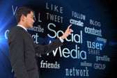 Composite image of serious asian businessman pointing — Stock Photo