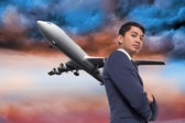 Composite image of unsmiling asian businessman with arms crossed — Stock Photo
