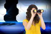Casual young woman using binoculars — Stock Photo