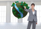 Businesswoman pointing to something — Stock Photo