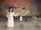Businesswoman holding black umbrella — Stock Photo