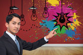Composite image of stern asian businessman pointing — Stok fotoğraf