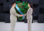 Hand shaking trading partners — Stock Photo
