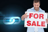 Model holding a for sale sign — Stock Photo