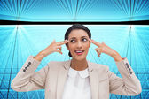 Composite image of confident young businesswoman — Stock Photo