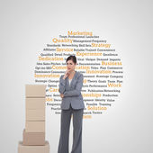 Thoughtful businesswoman posing with cardboard boxes — Stock Photo