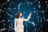 Composite image of brunette businesswoman pulling — Stock Photo