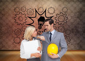 Architects with plans and hard hat looking at each other — Stock Photo
