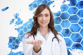 Smiling doctor presenting her hand — Stock Photo