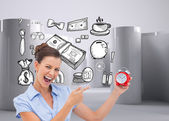 Businesswoman indicating alarm clock — Stock Photo