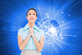Composite image of troubled young businesswoman praying — Stock Photo