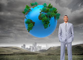 Businessman with hands in pockets — Stock Photo