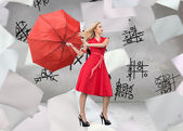 Elegant blonde holding umbrella — Stock Photo
