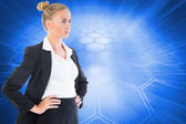 Businesswoman standing with hands on hips — Stock Photo