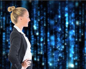 Composite image of businesswoman standing with hands on hips — Стоковое фото