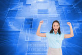 Composite image of victorious stylish businesswoman posing — Stock Photo
