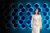 Composite image of smiling businesswoman walking — Stock Photo