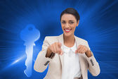 Composite image of smiling businesswoman pointing at the camera — Stock Photo
