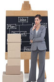 Businesswoman posing with cardboard boxes — Stock Photo