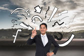 Composite image of smiling asian businessman pointing — Foto Stock