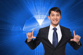 Composite image of smiling businessman holding — Stock Photo