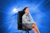 Serious businesswoman sitting — Stock Photo