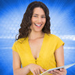Composite image of smiling casual young woman scrolling on her tablet computer — Stock Photo #38540355