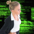Stock Photo: Composite image of businesswoman standing with hands on hips