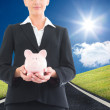 Composite image of businesswoman holding piggy bank — Stock Photo #38541483
