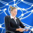 Stock Photo: Composite image of businesswomsitting on swivel chair with ta