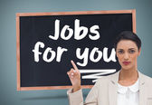 Composite image of serious businesswoman with hands up — Stock Photo