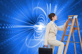 Composite image of businesswoman climbing career ladder with briefcase — Stock Photo
