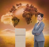 Thoughtful woman with cardboard boxes — Stock Photo